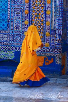 """A local """" Sindhi/ Rajisthani """" woman with a covered face entering the Sufi Shrine to pay homage."""