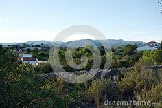 Photo about A view of the Spanish mountains south of Barcelona in the state of Tarragona Spain in the deltebre mountain range along the mediterranean coast. Image of view, mountain, south - 79913003 Tarragona Spain, Barcelona, Mountain Range, Spanish, Coast, Mountains, Nature, Image, Naturaleza