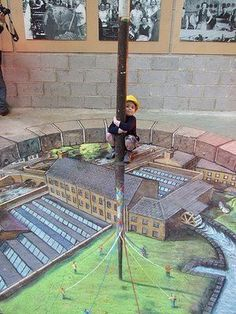 Pavement art - incredible. What I wonder is: is the kid real or drawn? Where does the picture start and end?!