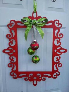 Thin wooden frame from Michaels ($8.99) painted red.  This is perfect for front doors that have a storm door too!