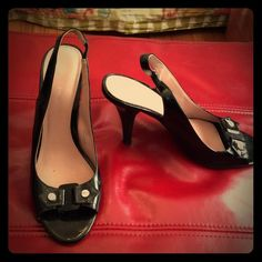 Lovely Calvin Klein patent leather slingbacks. Beautiful Calvin Klein Black patent leather slingback pumps. Size 7.5. Worn, but in great shape. Cute stylized buttons on the top and elasticized portion on the slingback. Perfect for work or out to dinner. Calvin Klein Shoes Heels