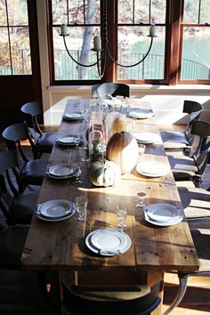 Love the idea of a GIGANTIC recycled wood table with some really nice leather or upholstered charis