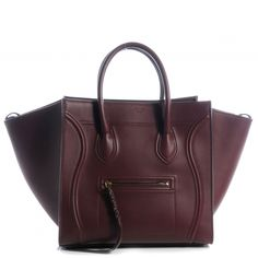This is an authentic CELINE Natural Calfskin Small Phantom Luggage in Burgundy.   This is a stylish bag that is a large tote or a small piece of luggage crafted of luxurious leather.