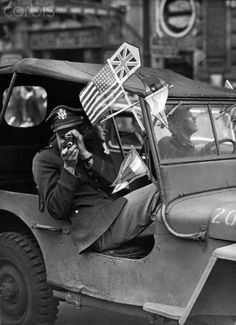 A U.S. Army officer snaps a photo of the revelry in London's Piccadilly Circus on V-E Day, May 8, 1945.