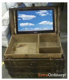 What an idea... put your flat screen tv inside a trunk coffee table! cool!
