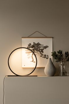 Loop lamp is a sculptural object with a warm glow of light.