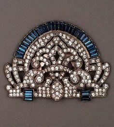 An Art Deco paste clip brooch, United States, 1930s. Paste stones and rhinestones set in metallic mount. 6.35 x 6.35 cm. #ArtDeco