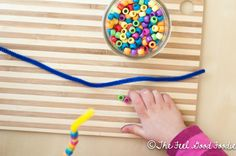 toddler activity: pony beads and pipe cleaners