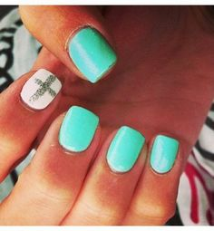 These are really cute nails; i really like the silver cross on them c:
