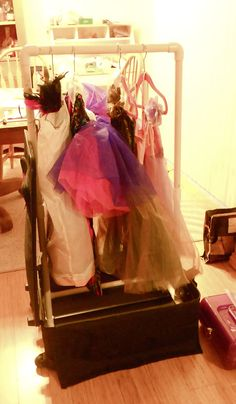 Emma's dance costume rack made out of PVC pipes and an old suitcase. Total cost $7.40 WAY cheaper than a Dream Duffle or Rac-n- Roll.. We have used this rack for 2 competition seasons now, it is a life saver.