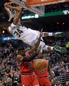 Milwaukee Bucks' Giannis Antetokounmpo dunks over Chicago Bulls' Rajon Rondo and Jimmy Butler during... - Morry Gash/AP Photo