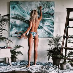 """Home studio time. Touching up an artwork before breakfast  @mgra_swimwear  #ArtistLife @mitchgobel_resinart #beachsoon"""