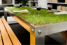 PicNYC. The perfect table to blend both the rural and urban landscapes together. You can even grow herbs, flowers, vegetables and other plants in the table's planted.