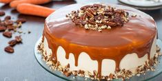 Carrot Cake - two layers of really moist carrot cake frosted with the best caramel cream cheese frosting ever and topped with plenty of caramel sauce. Toasted pecans also bring a great texture and flavor . Box Carrot Cake Recipe, Carrot Cake Frosting, Moist Carrot Cakes, Recipe Box, Round Cake Pans, Round Cakes, Fondant Au Caramel, Cake Recipes, Dessert Recipes