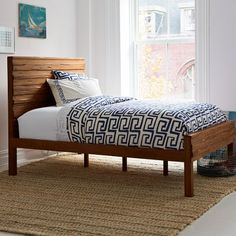 contemporary bedframe made of reclaimed saal wood from Indian railway trestles, $800
