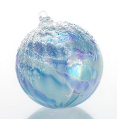 """Gossamer Moonrise"" #art glass #ornament by Tom Stoenner. In shimmering shades of aqua, sky, and periwinkle, this opalescent globe glistens with a frosting of icy droplets. An Artful Home exclusive."