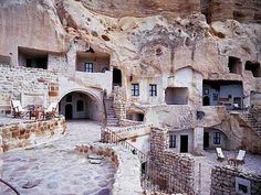 In the magical landscape of fairy tales of Cappadocia, the ancient village of Urgup - Turkey, there is a unique hotel carved into a cliff, the Hotel Yunak Evleri. The hotel includes six cave houses and 30 rooms, dating from the fifth and sixth centur Oh The Places You'll Go, Places To Visit, Cave Hotel, Hotels In Turkey, Cappadocia Turkey, Spain And Portugal, Andalusia, Malaga, Travel Destinations