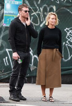 Back to black: Model Lara Bingle covered up in her favourite sweater for a wander around New York on Sunday