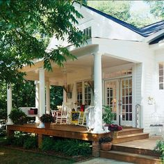 Moving Out Back              Extend your living space off the back of your house with a raised platform and overhang. This simple porch design includes a ceiling fan, classic columns, and the quintessential porch swing. French doors provide easy access to nature