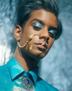 male of Indian descent wearing blue eye shadow + nose piercing + nose ring Face Reference, Photo Reference, Piercings, Mode Inspiration, Character Inspiration, Pretty People, Beautiful People, He's Beautiful, Beautiful Pictures