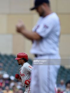 MINNEAPOLIS, MN - JUNE 23: Kevin Jepsen #49 of the Minnesota Twins looks on as Freddy Galvis #13 of the Philadelphia Phillies rounds the bases after hitting a three-run home run during the eighth inning of the game on June 23, 2016 at Target Field in Minneapolis, Minnesota. The Phillies defeated the Twins 7-3.