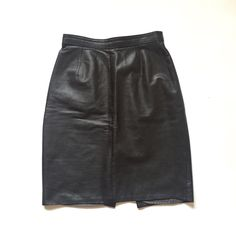 Beautiful vintage high waisted leather skirt 👸🏻 Super high quality black pencil skirt from the 1990s! size 8. Invisible zip for back closure. In flawless condition. Instant buy is on! ✨