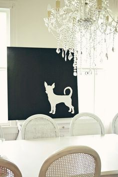 A silhouette of our chi puppy:) I wanted a pop of black in our all white dining room.