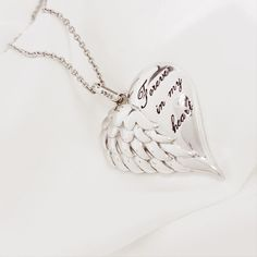 """Wear this delicate handmade silver angel wing #heartnecklace to acknowledge the warmth of angels around you. Your angels will stay close to you, brush across your face or arms, or whispers in your ears. You will suddenly feel a struck of unearthly love wearing this """"Whispers of Angel"""" necklace.  https://www.lindastars.com/collections/together-for-ever-collection/products/a-sudden-struck-of-unearthly-love"""
