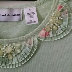 Beautiful Light Green Top *New Without Tags* It has green jewels intertwined with pearls around the color and the sleeves and bottom are laced as well! 55% Cotton and 45% Acrylic Alfred Dunner Sweaters Crew & Scoop Necks