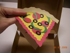 it's hard to get creative with the standard pizza party at the neighborhood games/pizza place.  so, i decided to get creative with the invitations and favors.  i used the personal pizza box to hold this invite.  on top it's a piece of pizza but open it up for party details!