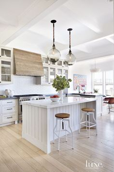Shiplap and beadboard wall paneling could be used on interior walls and ceilings too. They provide smooth horizontal lines as a design element in the room. This kitchen makes use of it around their island bench, genius!