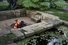 Outdoor stone firepit + bench