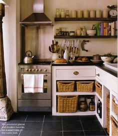 Basket Storage. Of course! Do away with the $1 billion kitchen remodel and take off the dang cabinet doors entirely. Still looks amazing!