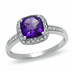 I2 clarity, I-J color Jewelry Adviser Rings 14k 9x7mm Oval Garnet A Diamond ring Diamond quality A