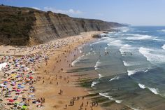 Why Portugal Is The Atlantic's Greatest Little Slice Of Heaven - via The Huffington Post 14.08.2015 | With its rich history and delicious cuisine, there's a lot to love about Portugal. But we're feeling some serious wanderlust thanks to its 750 miles of stunning coastline and Mediterranean climate -- a combo that makes a case for being some of the best beaches in all of Europe. Photo: Aerial view of the Magoito beach located near Sintra (Portugal)