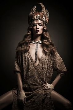 Dramatic Lighting and headpiece Fashion Editorial shoot for Dark Beauty Magazine. Model wearing headpiece and brown dress. Lindsay Adler Fashion Photographer.