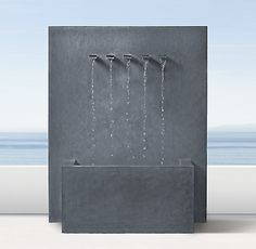 RH's Weathered Zinc Wall Fountain pure geometry of our modernist fountain is the perfect backdrop for a graceful jet of water. Handcrafted of powdercoated aluminum, this garden sculpture is striking in its simplicity. Outdoor Wall Fountains, Tabletop Water Fountain, Cat Water Fountain, Indoor Water Fountains, Indoor Fountain, Small Fountains, Indoor Outdoor Rugs, Outdoor Walls, Outdoor Planters