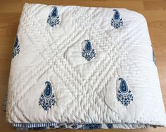 Introducing Cottage Chic! This lightweight cotton voile reversible bedding has been hand block printed and hand quilted. Inspired by calm blue waters, this piece is absolutely stunning!