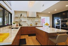 good looking & unusual kitchen - no uppers, warm wood lower, wall of dark (Jennie Garth's Hollywood Hills Home Renovation)