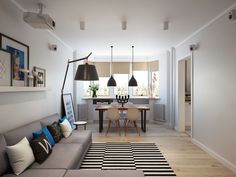 Living room and dining space rolled into one inside the modest Moscow apartment Going Scandinavian in Style: Space Savvy Apartment in Moscow