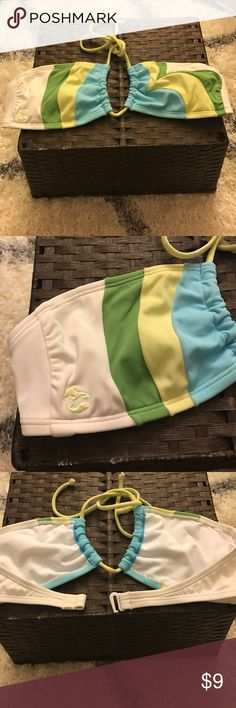 Billabong bikini top Strapless white bandeau bikini top with lime green, yellow and blue detail. Removable pads. White back closure. Washed after use. Fits 32-34 b cup *please see last picture with tiny spot on like green stripe Billabong Swim Bikinis