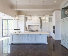 Transitional kitchen with white cabinets, cement backsplash tile and concrete flooring. Candelaria Design Associates