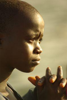 African Boy at  Lake Victoria Entebbe Uganda by Stephen G Woo Photo journey