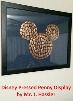 "This Disney Pressed Penny display was created by Mr. J. Hassler - The trick is to go to a coin dealer and buy rolls of pennies from before '82 when they were still all copper.... they press the best.  This one is about 200 pennies. Just use a strong craft clue to hold them in place on  a piece of colored foam core.  This frame is 22""x28"""