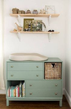 Not into pinks and blues for your nursery shelf? No problem. Try this adorable neutral option complete with wooden elements and shades of green. Simple and elegant.