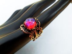 A fine cut of a Vintage Dragon's Breath Stone in a Copper Ring setting for the Modern Gladiator