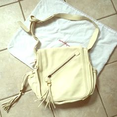 "Ferragamo ivory leather crossbody bag w/fringe! Gorgeous super soft ivory or cream leather with fun fringe details. Oversized crossbody bag in excellent condition measures a little over 13""x13"". Authentic Salvatore Ferragamo made in Italy. Includes dust bag. Ferragamo Bags Crossbody Bags"
