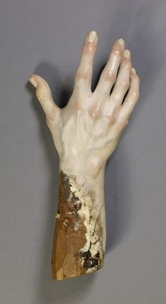 The right hand of Luisa Roldan's Saint Ginés de la Jara, made about 1692. She created the saint's form with wood boxes, then attached separately carved hands, feet, head, and robes from blocks.  + How the hand was painted.