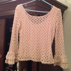 FREE PEOPLE CROCHET CROPPED SWEATER Free People crochet cropped blush colored sweater. A knit crochet with a cotton under layer. Flared wrist length sleeves. Has a soft lacey look. Worn once. Free People Tops