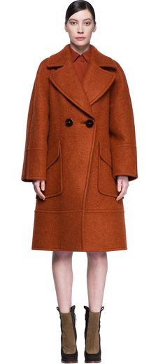 Double-breasted women's coat oversized,  with two big buttons on the front and large pockets. This coat is a great example of the special attention that Fendi puts on every piece of collection. Design, fashion, creativity, all combine in the same element, and what may appear a simple coat is a piece of sensorial explosion.